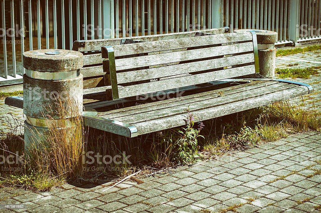 Modern bench with sidewalk stock photo