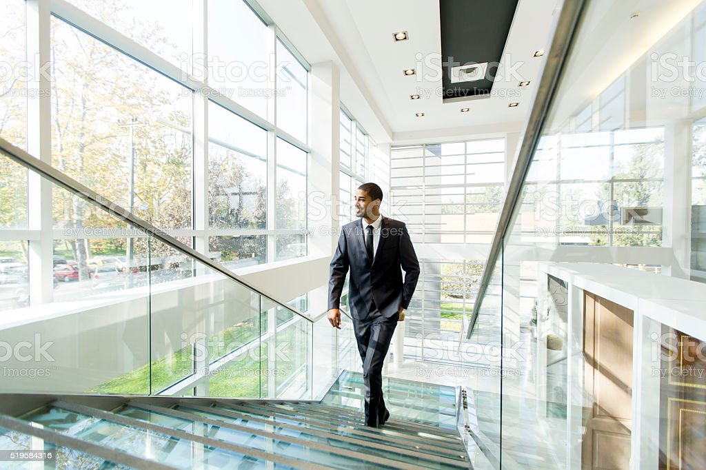 Modern black businessman on the stairs stock photo