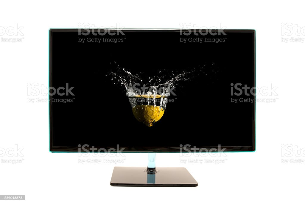 Modern black computer monitor with motion splash stock photo