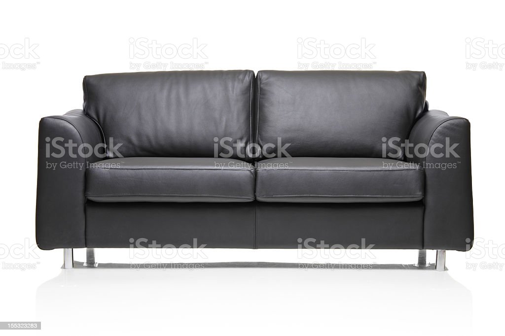 A modern black leather sofa isolated on a white background stock photo