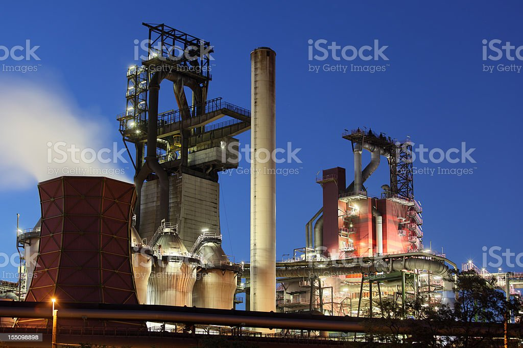 Modern blast furnaces at dusk stock photo