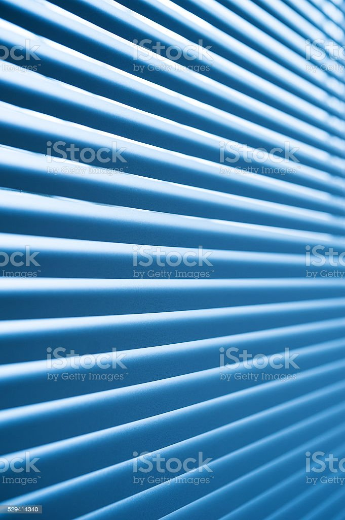 modern blue plastic Shutter Blinds in room stock photo