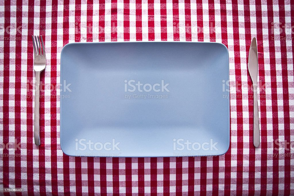 modern blue rectangular plate on red checkered tablecloth royalty-free stock photo