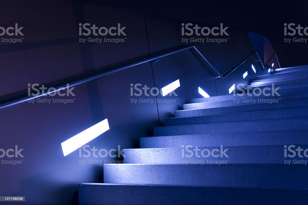 modern blue staircase with lights stock photo