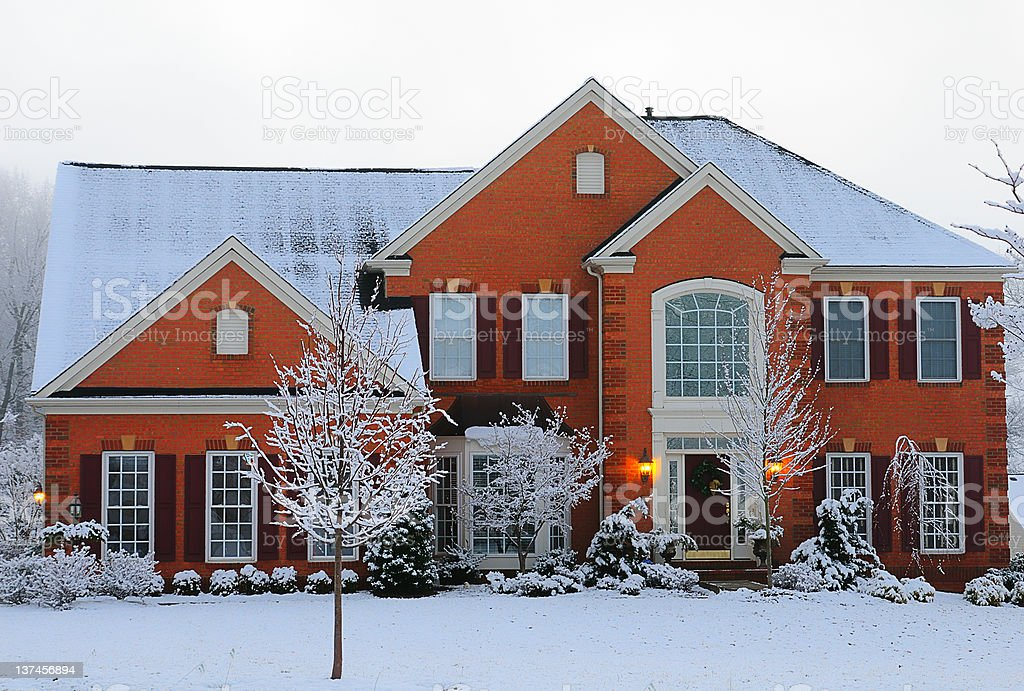 Modern Brick House in Snow stock photo