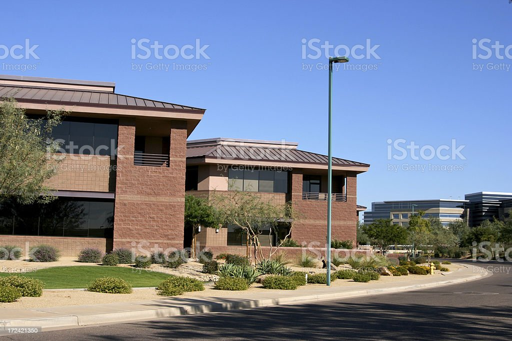 Modern brick office complex and landscaping and sidewalk royalty-free stock photo