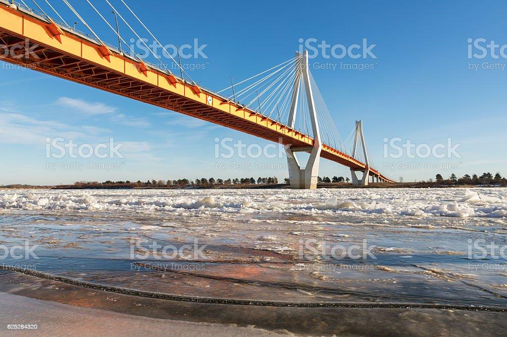 modern bridge over the frozen river stock photo