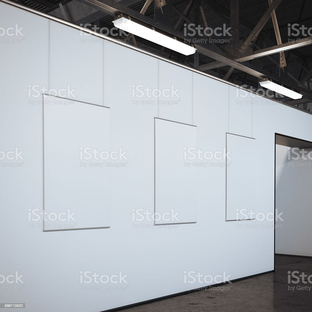 Modern bright gallery with three white frames. 3d rendering stock photo