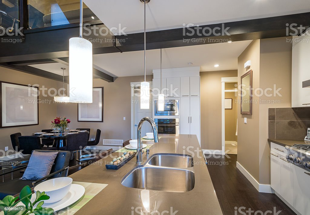 Modern, bright, kitchen and dining room. Interior design. stock photo