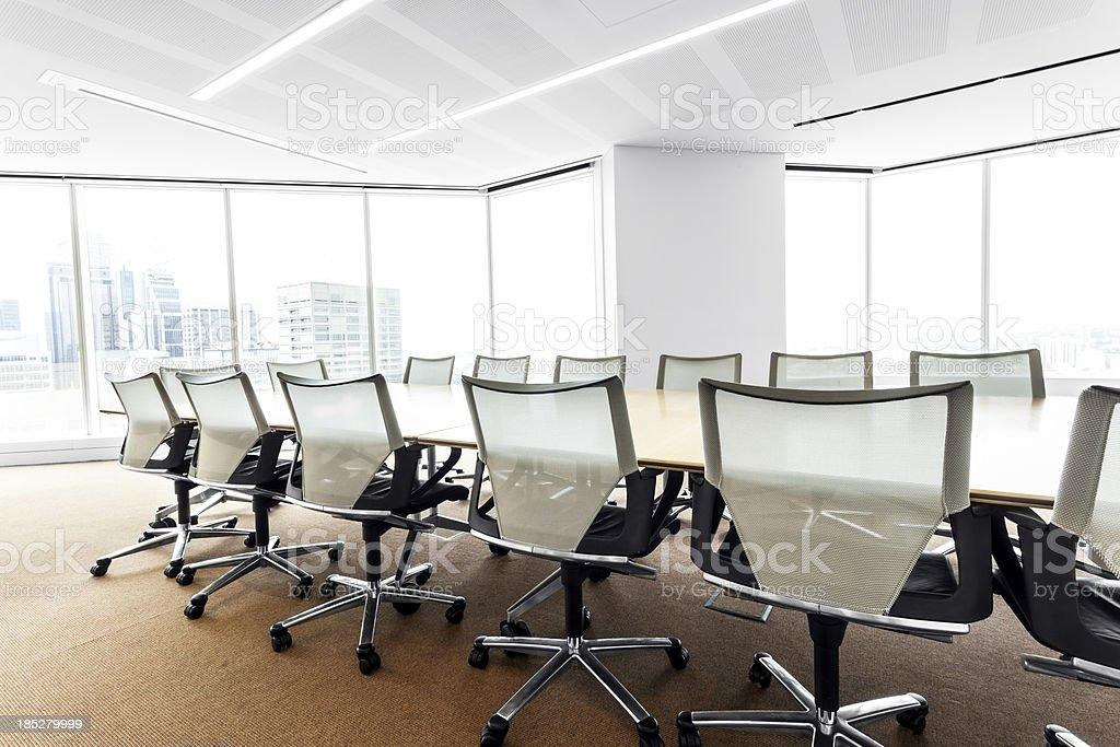 Modern, brightly lit boardroom stock photo