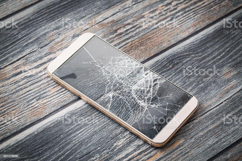 Modern broken mobile phone. stock photo