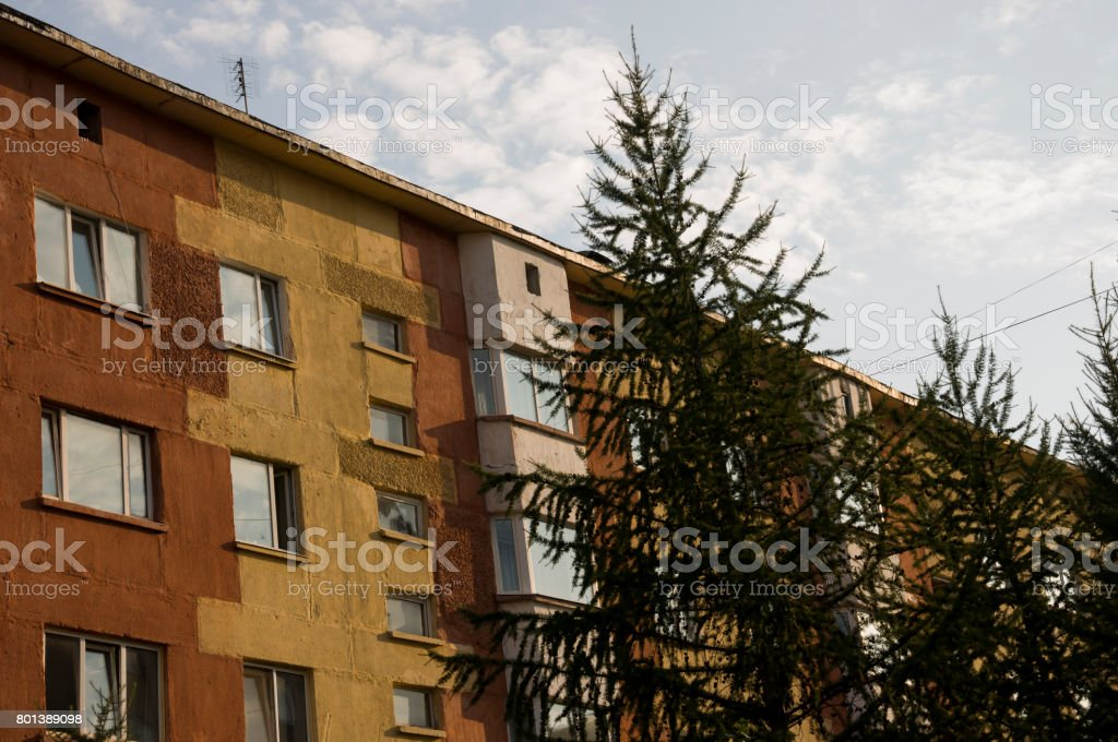 Modern brown three-storeyed building in the city stock photo