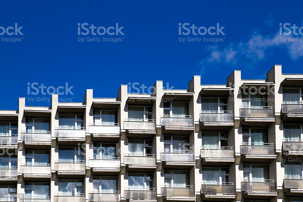 Modern building front wall with repeating pattern of windows and stock photo
