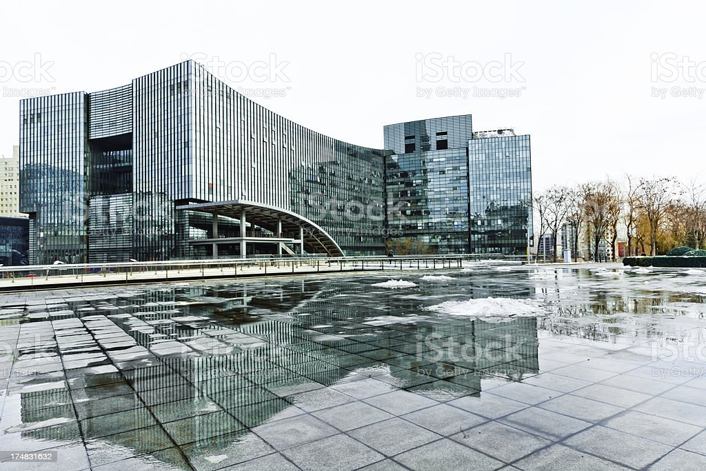 modern building reflection in square royalty-free stock photo