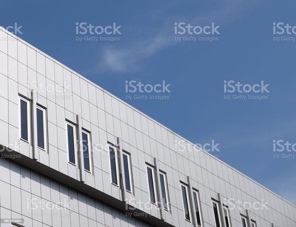 Modern building under a blue sky stock photo