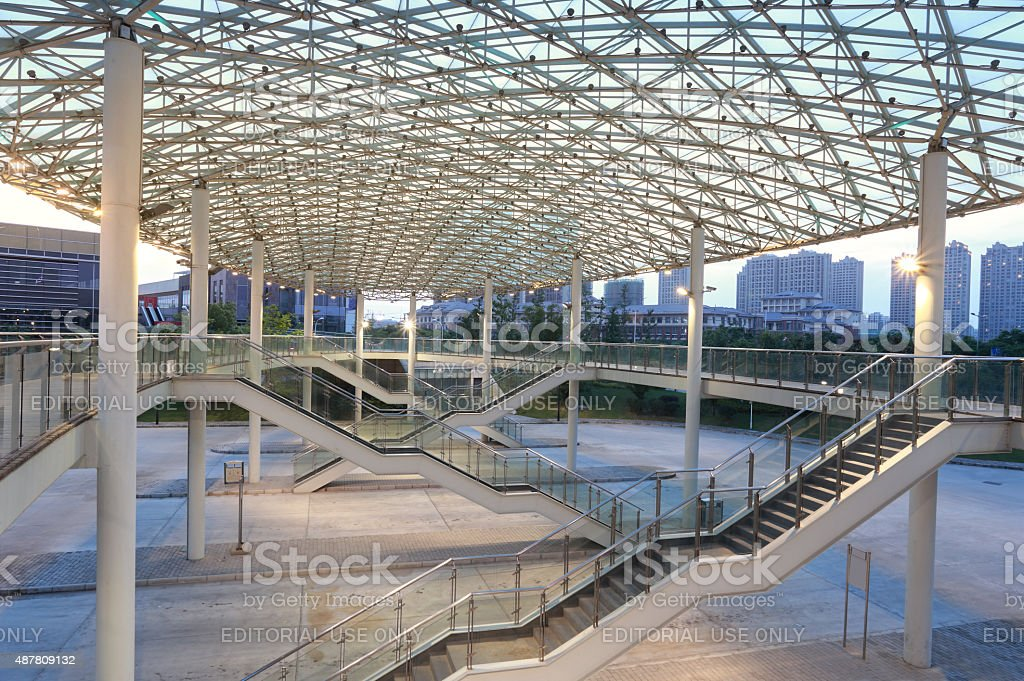 Modern building with curving roof and glass steel column stock photo