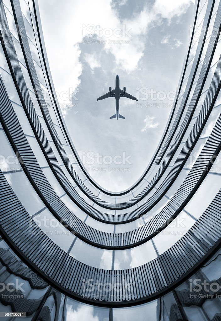 Modern building with flying airplane stock photo