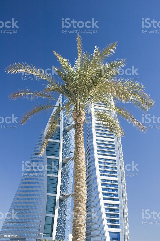 modern building with palm tree in Bahrain stock photo