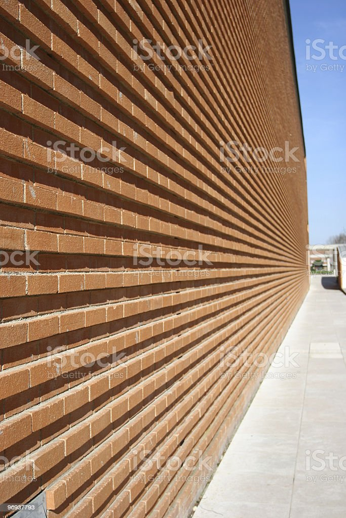 Modern Building with red bricked wall in perspective royalty-free stock photo