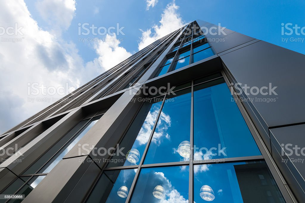Modern buildings against sky stock photo