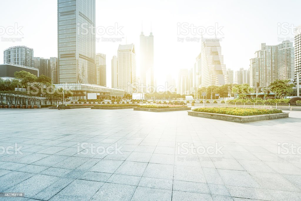 Modern buildings and empty square in urban city stock photo
