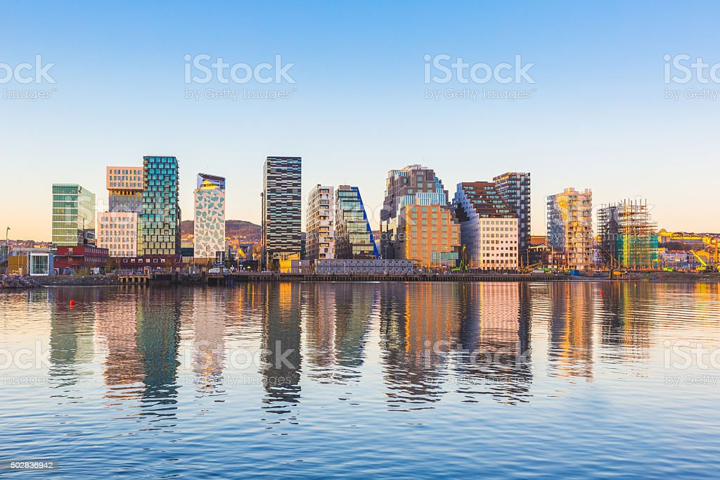 Modern buildings in Oslo with their reflection into the water stock photo