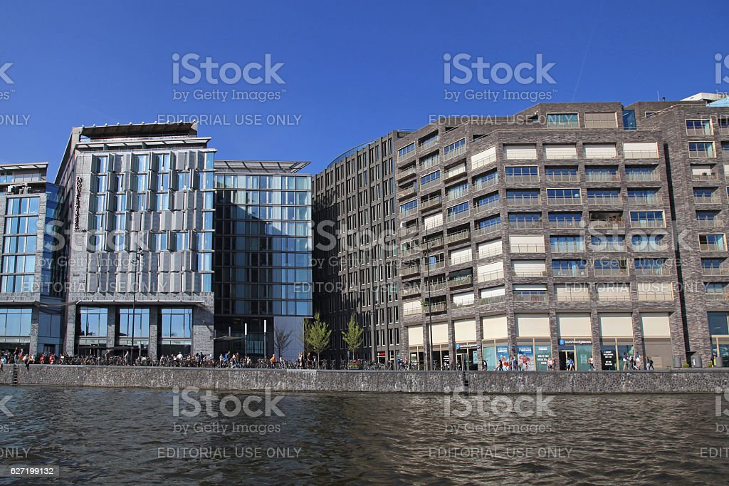 modern buildings on embankment of Amstel river in Amsterdam, Netherlands stock photo