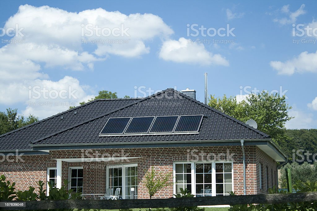 Modern bungalow with 4 small solar panels on roof stock photo