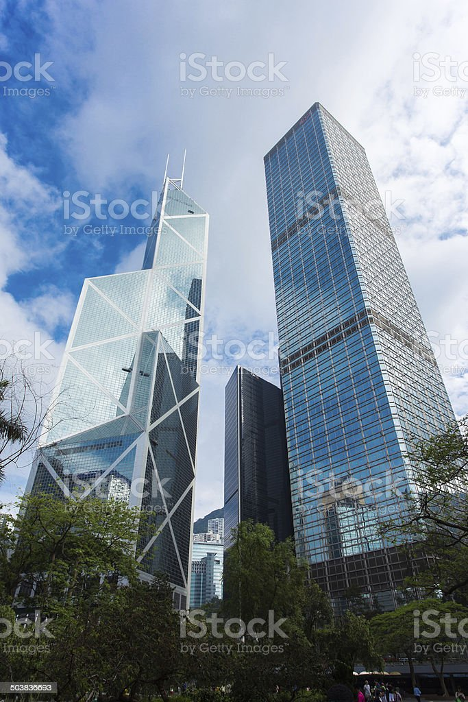 Modern business buildings with blue sky, shot in hong kong stock photo