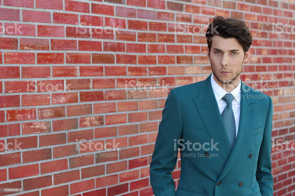 modern business man smiling standing outdoor stock photo