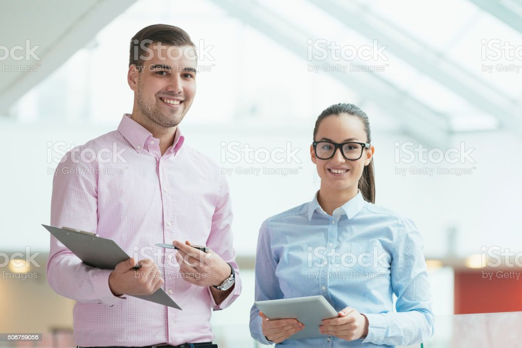 Modern business people in office building having business meeting stock photo