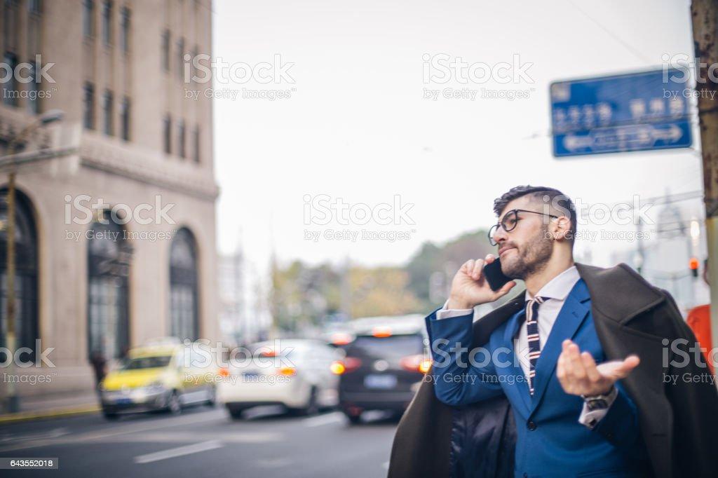 Modern businessman talking on mobile stock photo