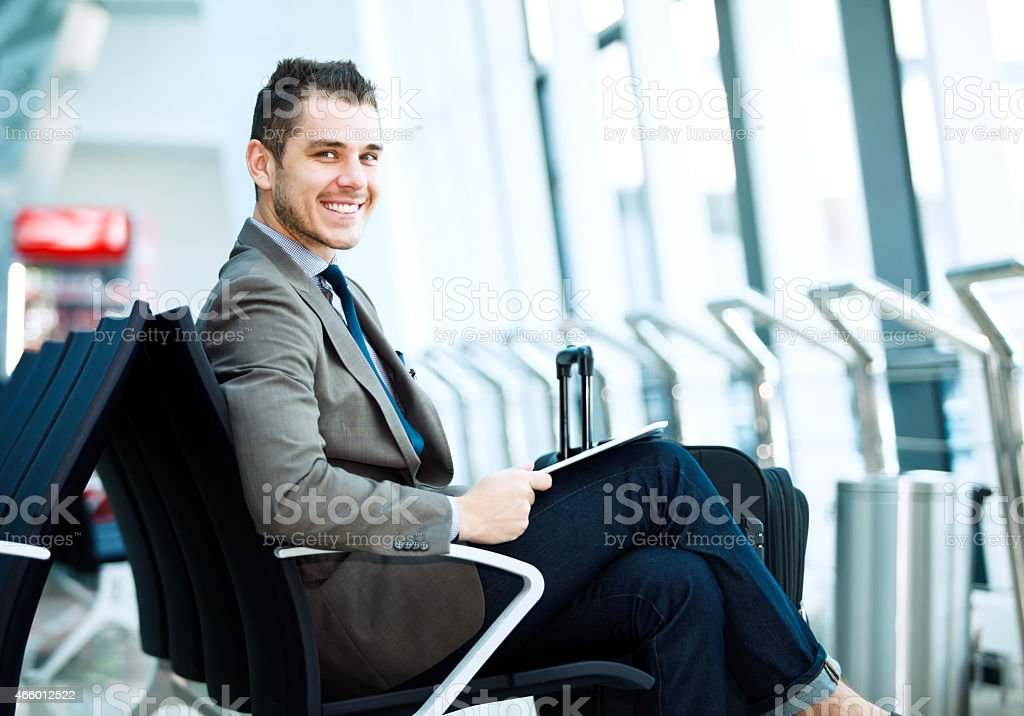 modern businessman using tablet computer at airport stock photo