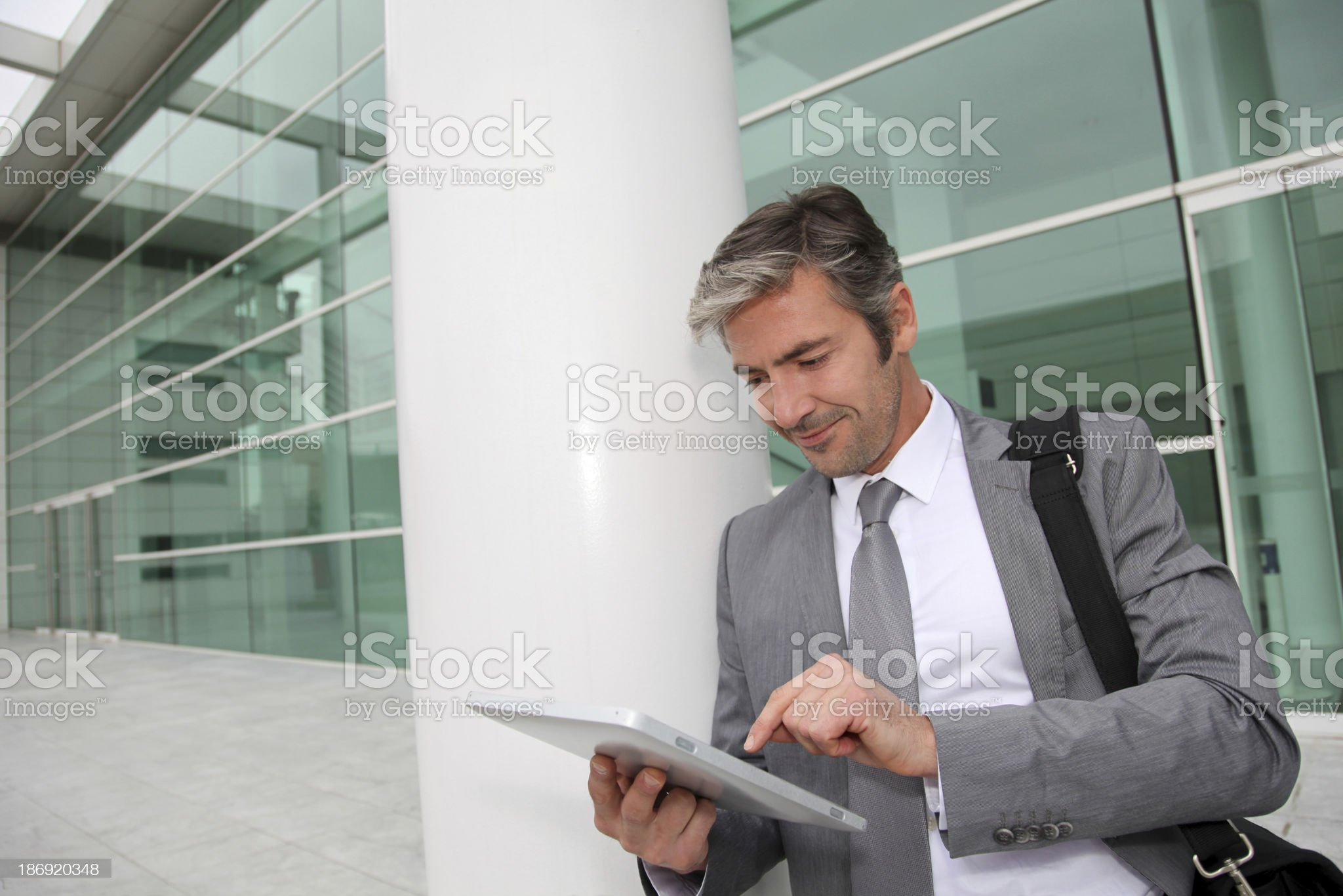 Modern businessman working and waiting for client royalty-free stock photo