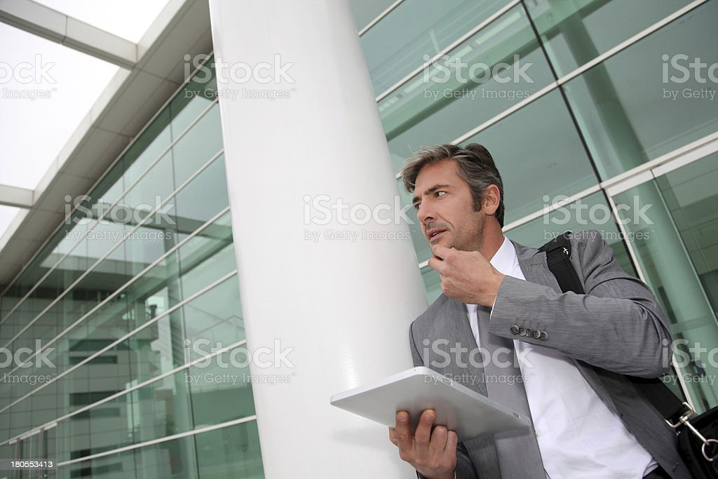 Modern businessmanwith grey suit working outdoors royalty-free stock photo