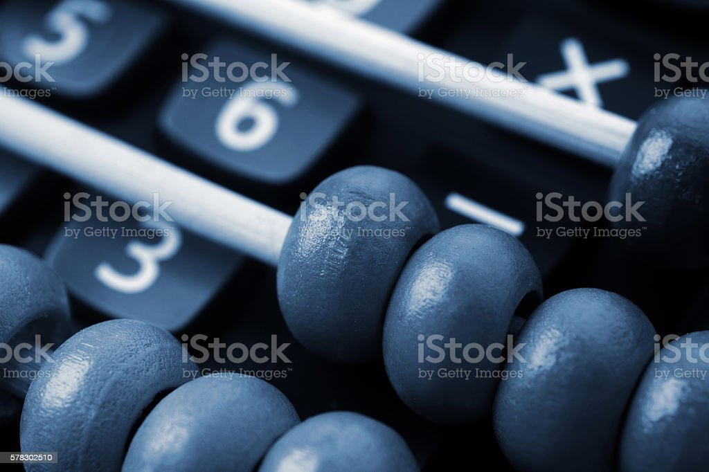 Modern calculator and abacus stock photo