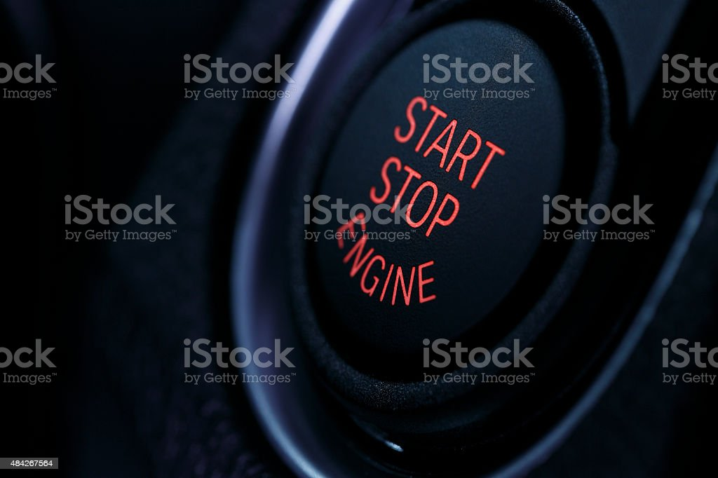 Modern car engine start / stop button stock photo