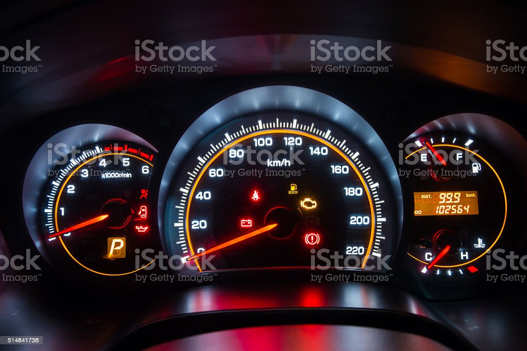 Modern car instrument dashboard panel in night time stock photo
