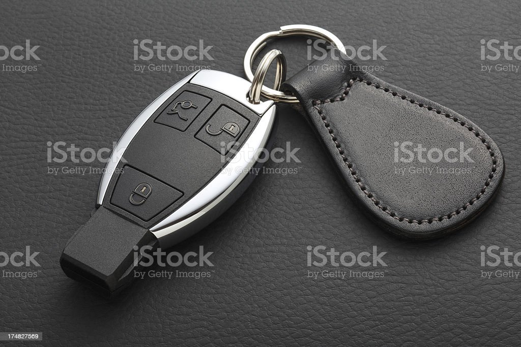 Modern Car Key and Remote on Black leather stock photo