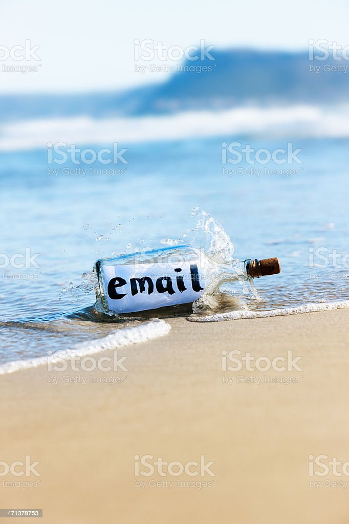 Modern castaway message in bottle: email stock photo
