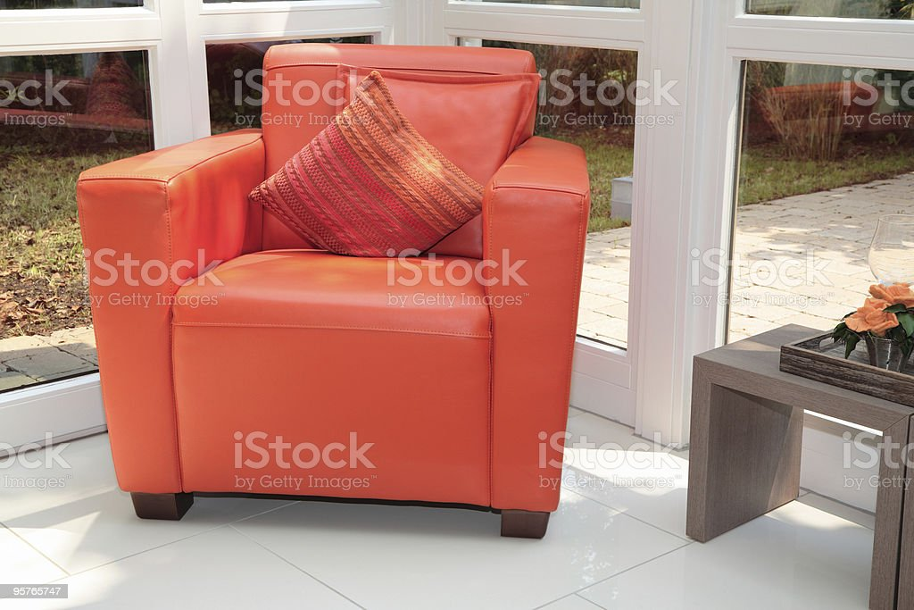 Modern Chair in a Sunroom royalty-free stock photo