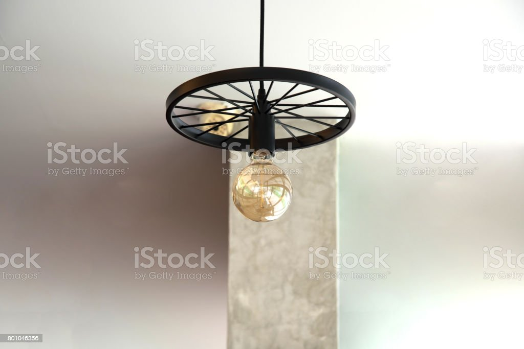 Modern chandelier lamp on white background hanging on the ceiling stock photo