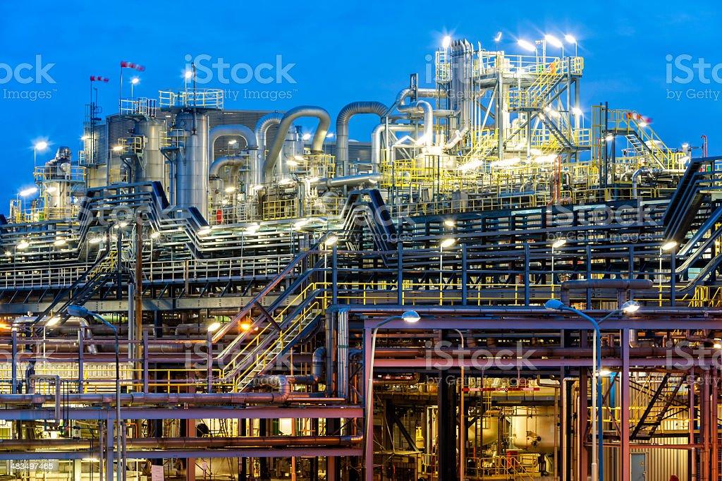 Modern Chemical Plant Illuminated At Dusk stock photo