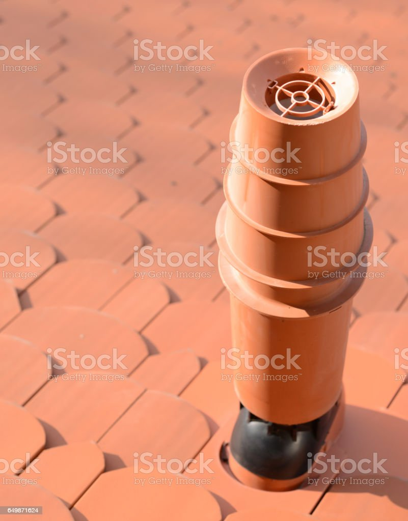 Modern chimney on roof stock photo