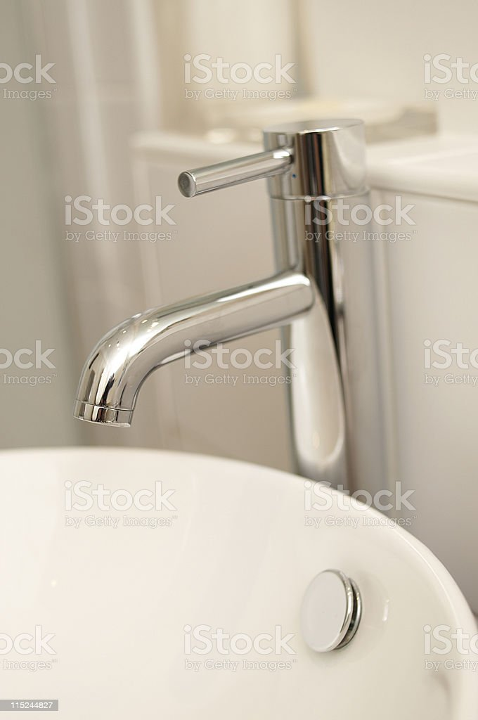 Modern chrome tap with white sink stock photo