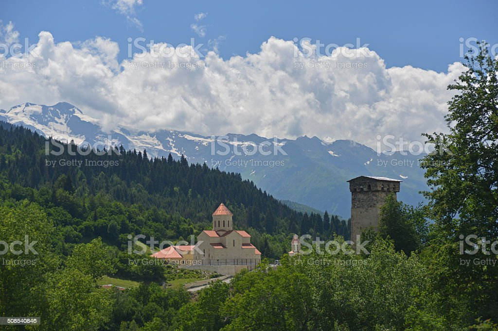 modern church and old tower in Caucasus Mountains stock photo