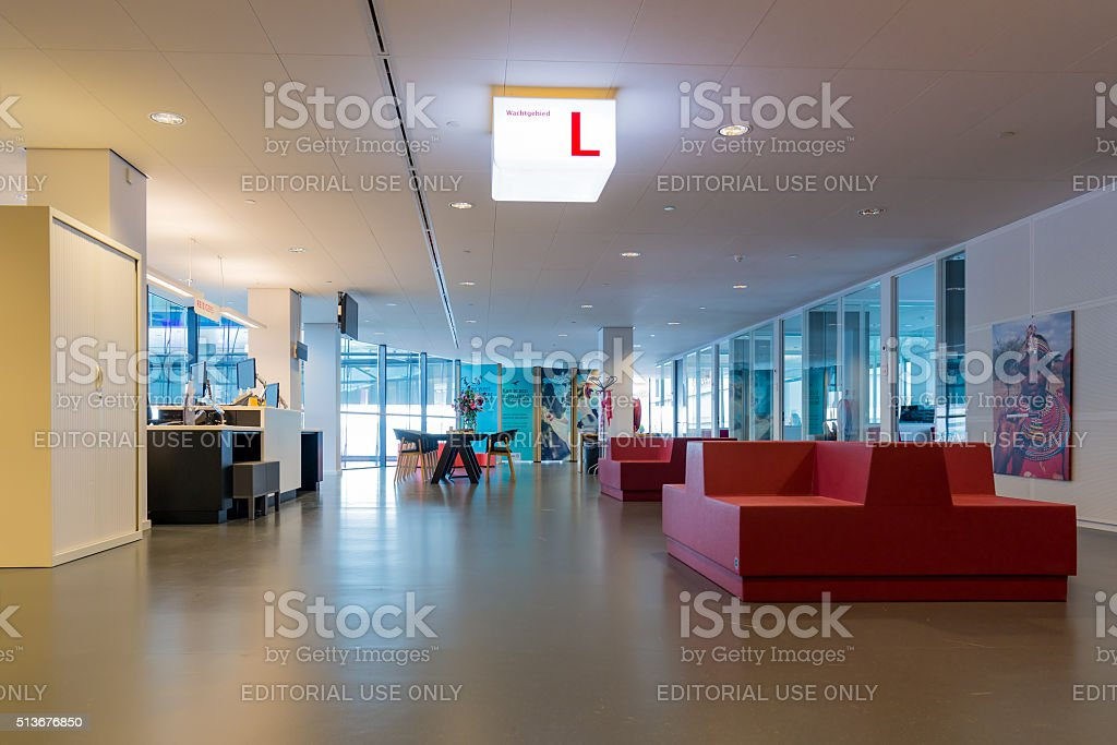 Modern city hall of Utrecht with waiting room for visitors stock photo