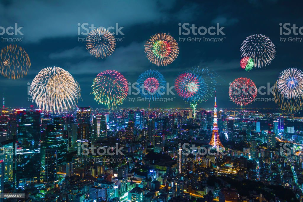 modern city night view and skyrocket fireworks stock photo
