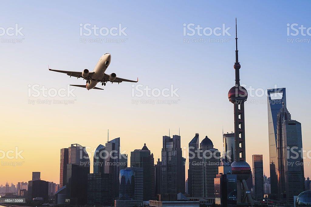 modern city skyline with airplane stock photo