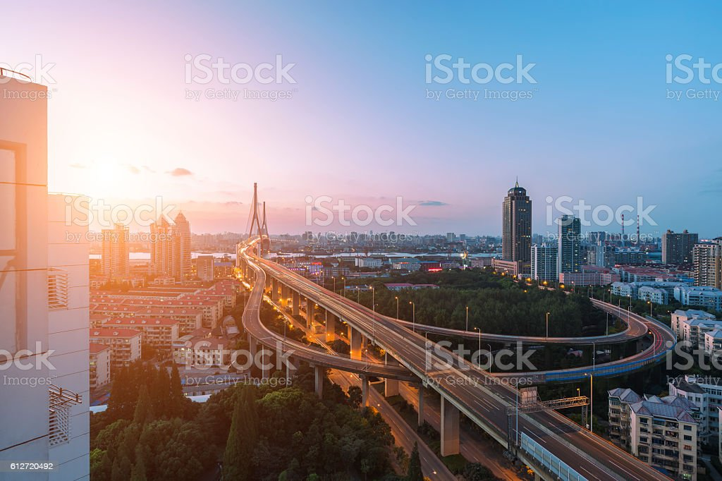 modern city with highway interchange in night stock photo